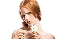 woman pulling off a flower petal