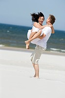 happy couple on beach