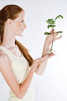 young woman holding plant
