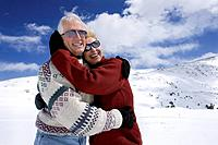 Senior Couple Embracing in Snow