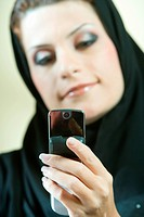 Arab businesswoman talking on phone in the office