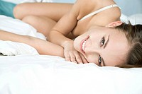 woman in underwear lying in bed