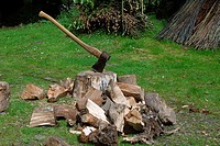 Chopped wood with axe and chopping block