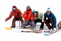Snowboarders and skier