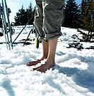 Man Standing Barefoot in Snow