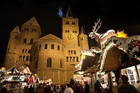 Cathedral of Trier and Chistmas market with snow at night, Trier, Germany