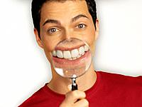 Man Holding Magnifying Glass in Front of His Teeth