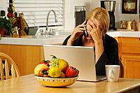 Woman on Cell Phone & Laptop