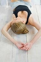 young woman lying on floor