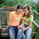 Girls Listening to Music on Porch