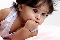 Joyful baby girl in dress lie down MR765