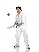 Indian batsman juggling with globe MR702A