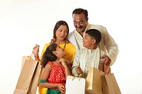 South Indian parents and children holding shopping bags MR748S,748T,748U,748V