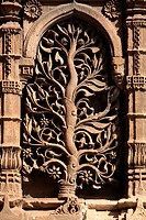 Craving depicting plant on wall of Bibiji mosque in Ahmedabad , Gujarat , India heritage