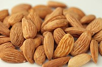 Dry fruits , almonds badam on white background