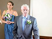 Father of bride by bridesmaid
