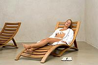 Young woman relaxing on sun_lounger