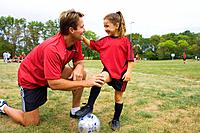 Soccer Coach Teaching Girl