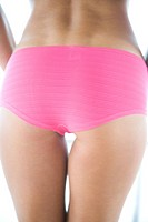 back of a woman in pink panties