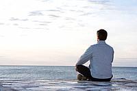 Man meditating at the sea