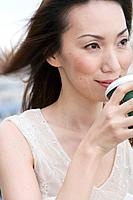 Woman Drinking From Disposable Cup