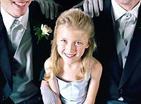 Girl Sitting with Groomsmen at Wedding
