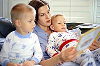 Mother Reading to Twin Sons