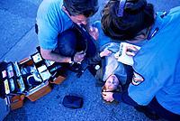 Paramedics Tending to Young Boy