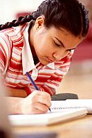 Adolescent Girl Writing in Notebook