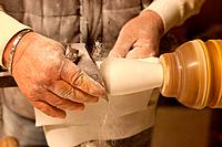 An artist finishes a piece of Alabaster in Volterra, Tuscany.