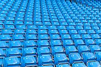 Rows of blue seats at the Manchester City football stadium in Manchester, England