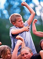Boy and Other Children Flexing Muscles