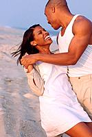African American Couple Dancing on Beach