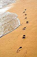 Footprints on a beach.