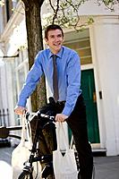 A businessman on his bicycle with shopping bags (thumbnail)