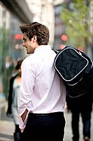 A businessman walking, carrying a gym bag (thumbnail)