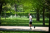 A young man jogging in the park (thumbnail)