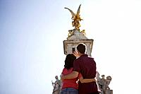 A young couple taking a picture of the Victoria Memorial