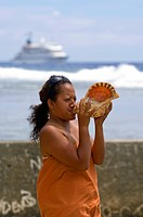 Island woman blowing conch shell, Cook Islands, Atiu