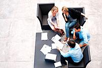 Top view of a hard working business people sitting together and working on documents