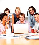 Portrait of smiling business people at meeting in office