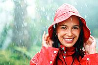 Woman smiling outdoors in rainy weather
