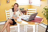 Businesswoman on Cell Phone at Home