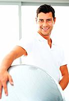 Portrait of young man posing with exercise ball