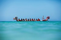Hawaii, Oahu, Waikiki, Group of people row a Dragon Boat in the open ocean. EDITORIAL USE ONLY