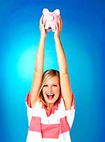Blonde woman holding up piggybank