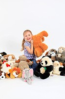 little happy girl playing with soft toys