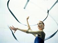 Woman performing Rhythmic Gymnastics with ribbon