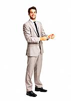 Full length of business man buttoning his cuff on white background