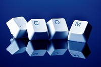 four computer keys adding up to the internet domain ´.com´